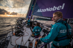 Leg 02, Lisbon to Cape Town, day 13, on board AkzoNobel. Nicolai Sehested looking out for approaching squalls that may bring some higher winds. Any speed the team can get they will take. Photo by James Blake/Volvo Ocean Race. 17 November, 2017.